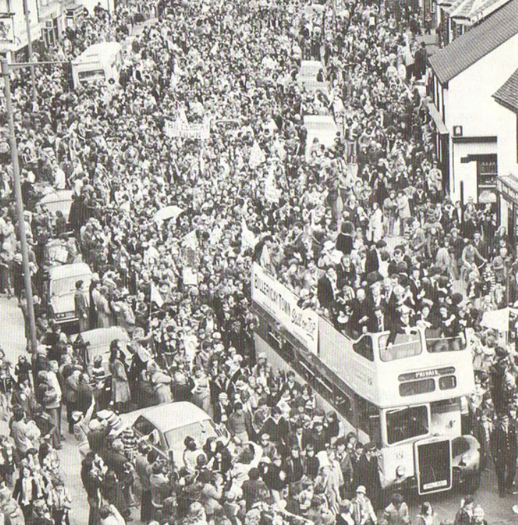 Text Box: Fans lining the streets following Billericay's 1976 FA Vase victory